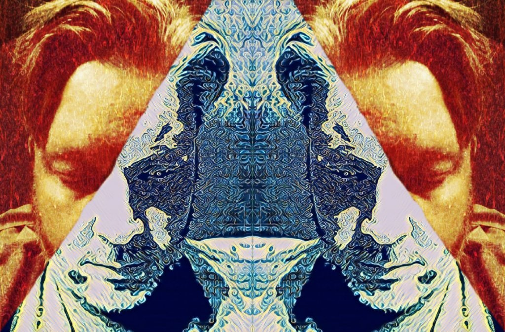 Mirror image of a male face that's been digital manipulated. The face has been split in red and blue colors