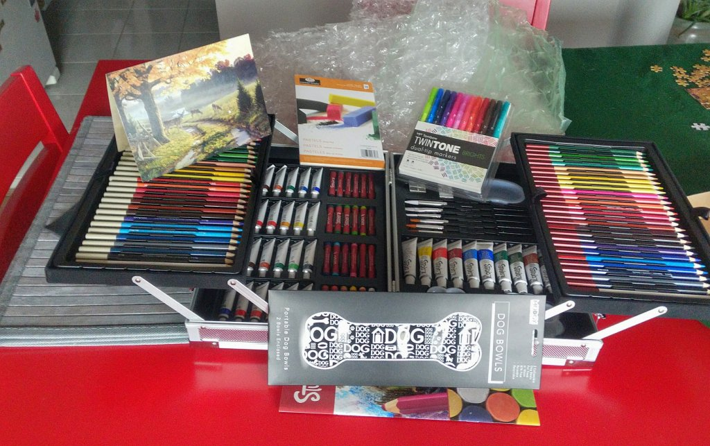 an art kit from my aunt with watercolor, acrylic, oil, pastels and more.