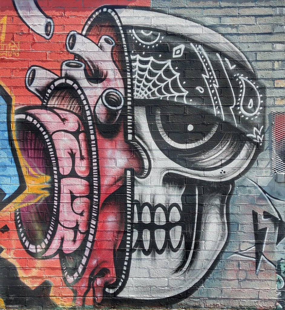 Street Art of a skull with a heart and a mind inside it